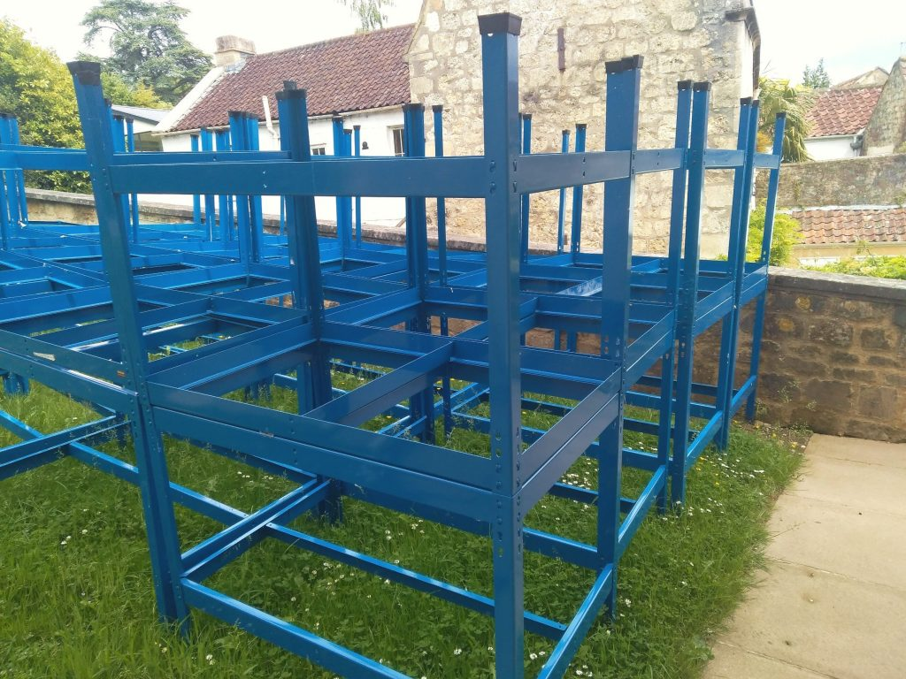 Untitled, painted metal bench frames, grass, dimensions variable, 2019 NFS